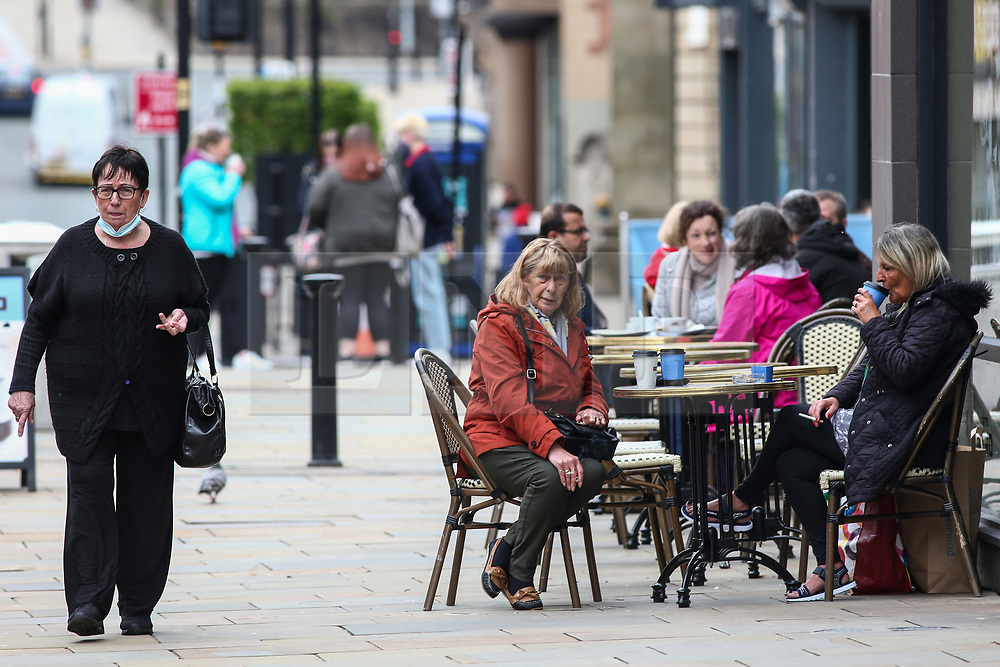 © Licensed to London News Pictures. 14/05/2021. Bolton, UK. People enjoy outdoor drinks in Bolton town centre on Friday afternoon. Bolton now has the highest infection rate in Britain at 192.3 cases per 100,000. Photo credit: Adam Vaughan/LNP
