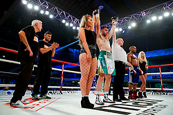 David Bailey of Bristol (green, white shorts) celebrates a points victory over Elvis Dube (blue shorts) in a Light Heavyweight bout on the undercard - Photo mandatory by-line: Rogan Thomson/JMP - 07966 386802 - 13/06/2015 - SPORT - BOXING - Bristol, England - Action Indoor Sports Arena - Lee Haskins vs Ryosuke Iwasa - Interim IBF World Bantamweight Title Fight - UNDERCARD.