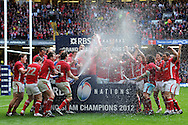 The Wales players celebrate after winning the RBS Six nations championship and grand slam. RBS Six nations champs 2012, Wales v France at the Millennium Stadium in Cardiff, South Wales on Saturday 17th March 2012.  pic by Andrew Orchard, Andrew Orchard sports photography,