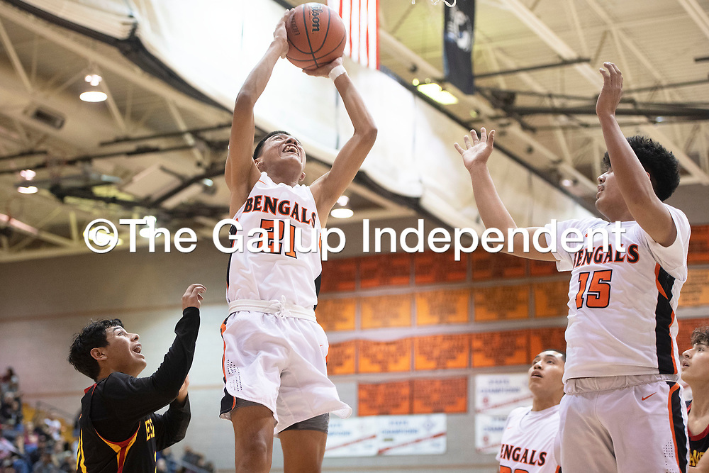 Gallup's Jeffrey Yazzie (21) takes a shot under the basket against Espanola Valley Thursday night in Gallup.
