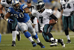 DETROIT - SEPTEMBER 19: Quarterback Michael Vick #7 of the Philadelphia Eagles scrambles during the game against the Detroit Lions on September 19, 2010 at Ford Field in Detroit, Michigan. The Eagles won 35-32. (Photo by Drew Hallowell/Getty Images)  *** Local Caption *** Michael Vick