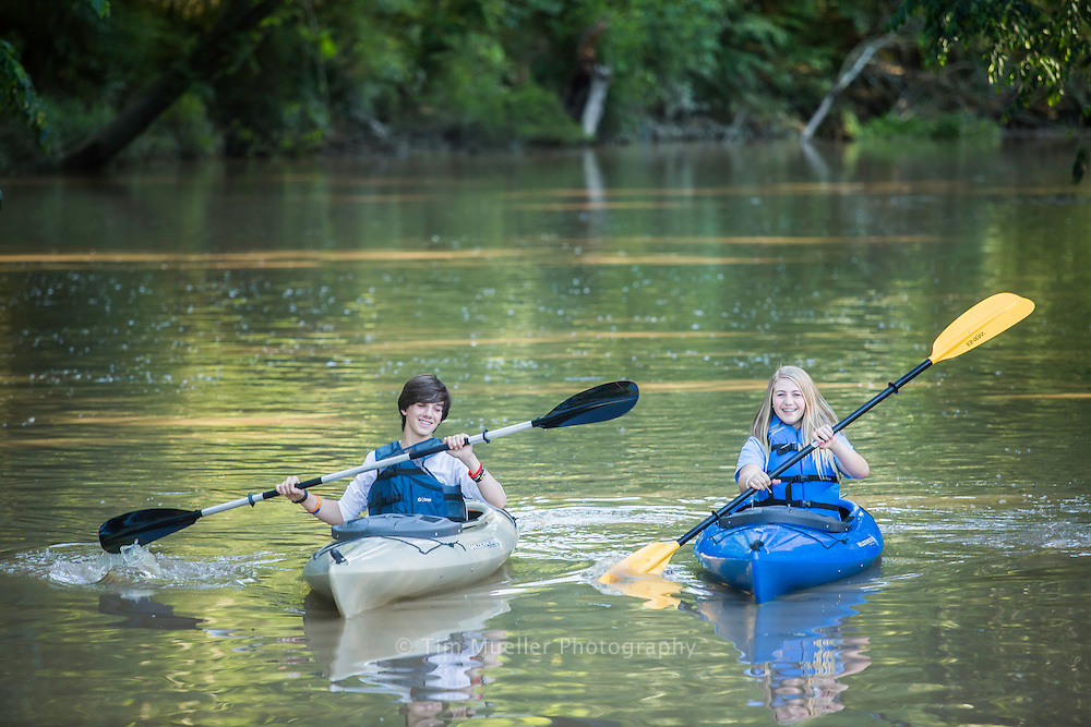 Macey Hicks and Anna Richard paddle Bayou Laccasine near Sportsman Park in Welsh, La.