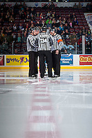 KELOWNA, CANADA - OCTOBER 23: Ice officials, Jeff Ingram, Mark Pearce, Kevin Crowell and Dave McMahon stand at centre ice as the Kelowna Rockets take on the Prince George Cougars on October 23, 2014 at Prospera Place in Kelowna, British Columbia, Canada.  (Photo by Marissa Baecker/Shoot the Breeze)  *** Local Caption *** Jeff Ingram; Mark Pearce; Kevin Crowell; Dave McMahon;