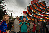 Maude, Scott and Hugo Aldridge check out the giant pumpkin tower during Saturday evenings Pumpkin Fest in downtown Laconia.  (Karen Bobotas/for the Laconia Daily Sun)