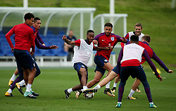 England's Raheem Sterling takes on a group of defenders - Mandatory by-line: Matt McNulty/JMP - 29/08/2017 - FOOTBALL - St George's Park National Football Centre - Burton-upon-Trent, England - England Training and Press Conference