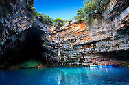 The Lake Melissani. inland cave with sea water, Kefalonia, Ionian Islands, Greece. .<br /> <br /> Visit our GREEK HISTORIC PLACES PHOTO COLLECTIONS for more photos to download or buy as wall art prints https://funkystock.photoshelter.com/gallery-collection/Pictures-Images-of-Greece-Photos-of-Greek-Historic-Landmark-Sites/C0000w6e8OkknEb8