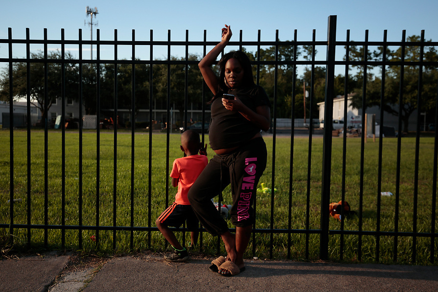 Kalacedtra Smith, who is eight months pregnant, is joined by her son Kameron Smith, 9, as she rest for a moment after inspecting the water damage in her Crofton Place Apartment in north Houston during the aftermath of Hurricane Harvey in Houston, Texas, U.S. September 8, 2017.