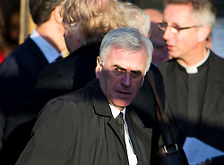 © Licensed to London News Pictures. 13/11/2015. London, UK. JOHN MCDONNELL after The funeral of former Labour MP Michael Meacher at St Mary's Church in Wimbledon, south west London.  Michael Meacher, who was a Labour MP in Oldham for over 40 years, served as Minister of State for the Environment in the Tony Blair government.  Photo credit: Ben Cawthra/LNP