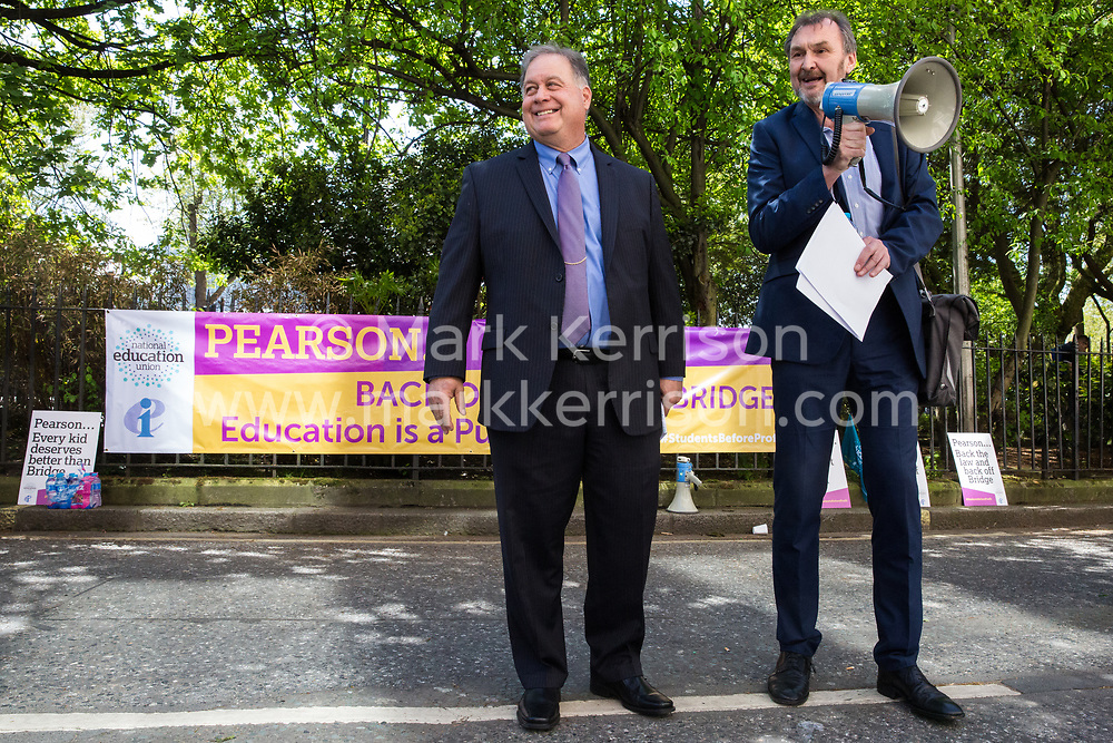 London, UK. 4th May, 2018. Kevin Courtney, Joint General Secretary of the National Education Union (NEU), introduces Rob Weil, Director of Field Programs at the American Federation of Teachers, at a demonstration outside the AGM of multinational assessment service Pearson in protest against investment by the corporation in 'low-fee' private schools provider Bridge. Bridge, one of the world's largest education-for-profit companies, aims to extend its influence throughout Africa and Asia.