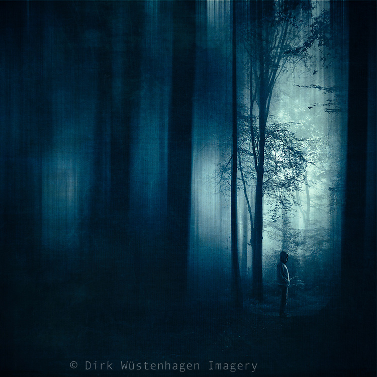 abstract dark blue forest scene with a man standing on a forest path