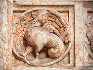 Medieval relief sculptures of mythical half man half dragon creature on the exterior of the Romanesque Baptistery of Parma, circa 1196, (Battistero di Parma), Italy .<br /> <br /> If you prefer you can also buy from our ALAMY PHOTO LIBRARY  Collection visit : https://www.alamy.com/portfolio/paul-williams-funkystock/romanesque-art-antiquities.html<br /> Type -     Parma    - into the LOWER SEARCH WITHIN GALLERY box. <br /> <br /> Visit our ROMANESQUE ART PHOTO COLLECTION for more   photos  to download or buy as prints https://funkystock.photoshelter.com/gallery-collection/Medieval-Romanesque-Art-Antiquities-Historic-Sites-Pictures-Images-of/C0000uYGQT94tY_Y