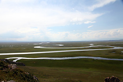 August 15, 2017 - China - Xinjiang, CHINA (EDITORIAL USE ONLY. CHINA OUT) ..Winding river across the Bayinbuluke Alpine Grassland in northwest China's Xinjiang. (Credit Image: © SIPA Asia via ZUMA Wire)