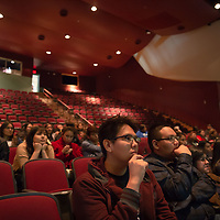 """Shiprock High School seniors Narbona Begay, left, and Noah Hastins, right, listen to the forum speakers on stage. The """"Education is our Human Right"""" forum was held at the Phil L. Thomas Performing Arts Center in Shiprock on Thursday."""