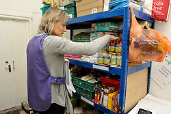 © Licensed to London News Pictures. 12/12/2013; Bristol, UK.  Volunteer Jenny sorts food donations and distribution at Bristol North West Food Bank distribution point at Lawrence Weston Baptist Church.  A wide range of people use the service, both those on benefits and those in work, and from a wide range of backgrounds.  Ffi: bristolnwfoodbank.org.uk  12 December 2013.<br /> Photo credit : Simon Chapman/LNP