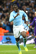 Yaya Toure of Manchester City celebrates after scoring the winning penalty in the penalty shoot out. Capital One Cup Final, Liverpool v Manchester City at Wembley stadium in London, England on Sunday 28th Feb 2016. pic by Chris Stading, Andrew Orchard sports photography.