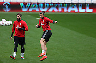 Gareth Bale ® and Joe Ledley of Wales (l) joke around during Wales football team training at the Cardiff city Stadium in Cardiff , South Wales on Saturday 8th October 2016, the team are preparing for their FIFA World Cup qualifier home to Georgia tomorrow. pic by Andrew Orchard, Andrew Orchard sports photography
