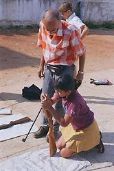 Secondary school girl loading gun during shooting lesson,
