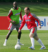 England training session at London Colney 01/09/09<br /> Photo Nicky Hayes Fotosports International<br /> Carlton Cole watches over Wayne Rooney in training.