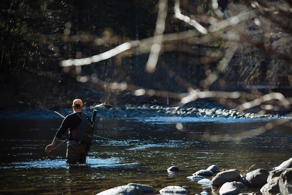 Alex Hudjohn. owner of H&H Outfitters fly fishing along the Wilson River, near Tillamook, Oregon.