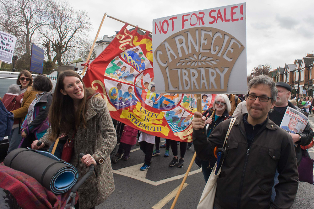 Campaigners against the closure by Lambeth council  of Carnegie Library in Herne Hill, south London, march through the borough, some after emerging from the premises on the 10th day of occupation, 9th April 2016. The local community have been occupying their important resource for learning and social hub and after a long campaign, Lambeth have gone ahead and closed the librarys doors for the last time because they say, cuts to their budget mean millions must be saved. They plan to re-purpose it into a gym although details are unknown.