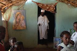 Priest Kewani stands inside St. Mary's church Coptic in Barentu, Eritrea August 27, 2006.  (Photo by Ami Vitale)
