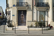"""March, 27th 2020 - Paris, Ile-de-France, France: Paris under confinement, Christies, Avenue Montaigne area of high fashion, beauty, accessories, haute couture, all shops closed, in 8th arrondissement, and all public spaces virtually empty to stop the spread of the Coronavirus, during the eleventh day of near total lockdown imposed in France. The President of France, Emmanuel Macron, said the citizens must stay at home for at least 15 days, that has been extended. He said """"We are at war, a public health war, certainly but we are at war, against an invisible and elusive enemy"""". All journeys outside the home unless justified for essential professional or health reasons are outlawed. Anyone flouting the new regulations is fined. Nigel Dickinson"""
