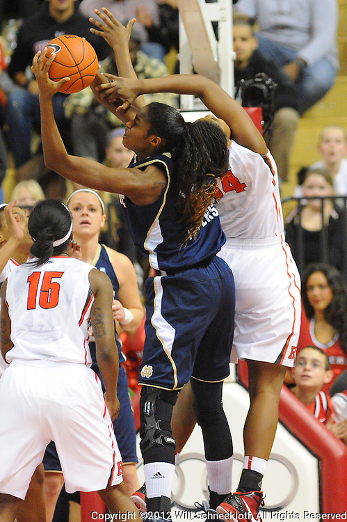 Notre Dame Fighting Irish forward Devereaux Peters (14) grabs a defensive rebound away from Rutgers Scarlet Knights forward/center Monique Oliver (34) during first half NCAA Big East women's basketball action between Notre Dame and Rutgers at the Louis Brown Athletic Center. Notre Dame leads 40-23 at halftime.