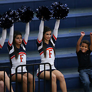Xander Ali, 5, right, does his best to keep up with the Cal State Fullerton cheerleaders' motions during the Hope International vs. Cal State Fullerton women's college basketball game at Titan Gym on Friday, Nov.  6, 2015, in Santa Ana, Calif.<br /> <br /> Photo by Mike Christy / Sports Shooter Academy