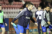 AFC Wimbledon defender Jon Meades (3) warming up during the EFL Trophy match between AFC Wimbledon and Luton Town at the Cherry Red Records Stadium, Kingston, England on 31 October 2017. Photo by Matthew Redman.