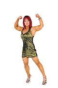 Female bodybuilder in evening dress, flexes her arm muscles