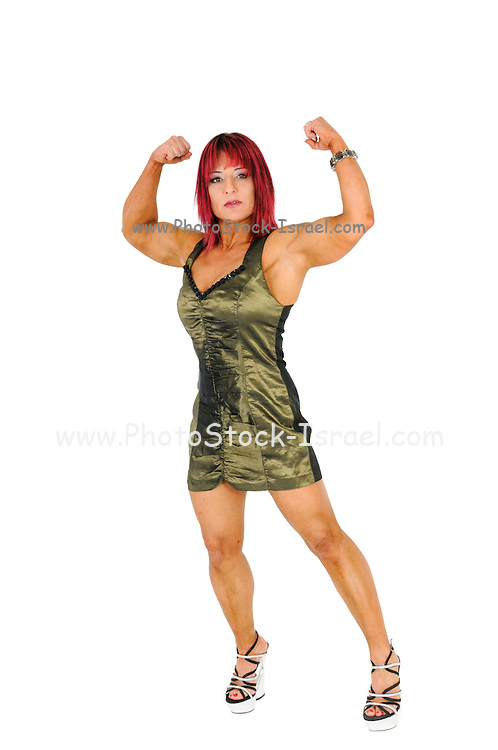 Female bodybuilder in evening dress, flexes her arm muscles