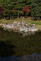 The Imperial Palace in Nara revealed the remains of an 8th-Century pond garden: the To-in Garden, workers preparing the ground discovered the remains of a stream garden--a yarimizu  that dates to the same period as the palace itself.  The winding stream echoes the Chinese, Korean and early Japanese tradition of a stream banquet during which guests attempted to come up with an original poem before cups of sake.  All that remain at To-in are the stream and the rocks placed along the banks of the stream and anticipates certain aspects of later Japanese garden elements.
