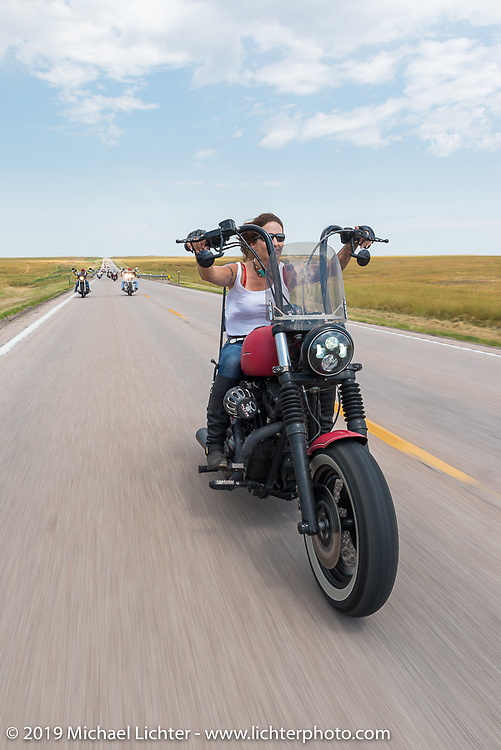 Debi Holmes of Westminster, Colorado rides back to Sturgis after the annual Michael Lichter - Sugar Bear Ride hosted by Jay Allen with the Easyriders Saloon during the Sturgis Black Hills Motorcycle Rally. SD, USA. Sunday, August 3, 2014. Photography ©2014 Michael Lichter.