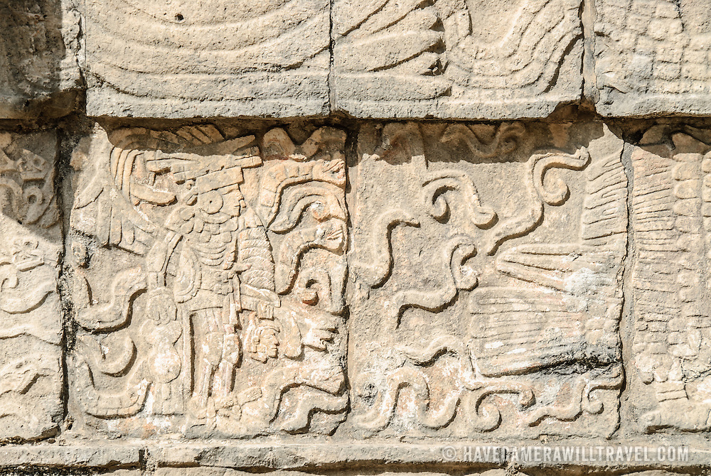 Winged warrior carving in a stone wall at Chichen Itza Mayan ruins, Mexico.