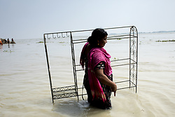 August 15, 2017 - Dhaka, Bangladesh - A woman moves her belongings to  another place after  floodwaters rose at Sariakandhi, Bogra. Flood-related incidents in Dinajpur, Gaibandha and Lalmonirhat raising the death toll to 30 in the last three days across the country. (Credit Image: © K M Asad via ZUMA Wire)