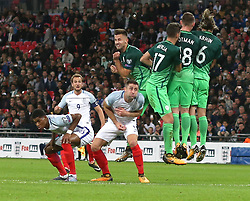 05 October 2017 Wembley: FIFA World Cup Qualifying Match : England v Slovenia : Marcus Rashford and Gary Cahill duck as Harry Kane fires his free kick into the Slovenian defensive wall.<br /> <br /> Photo: Mark Leech