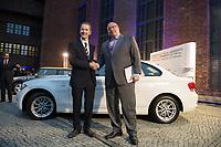 23 OCT 2012, BERLIN/GERMANY:<br /> Dr.-Ing. Herbert Diess (L), Mitglied des Vorstandsmitglied Entwicklung der BMW AG, begruesst Peter Altmaier (R), CDU, Bundesumweltminister, BMW Leistungsschau Elektromobilitaet, E-Werk Berlin<br /> IMAGE: 20121023-02-064<br /> KEYWORDS: Automobilindustrie, KFZ, Auto, Elektromobilität, E-Mobility