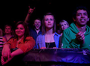 Kristy Corbeil, Lauren Sides and Douglas Westurn look on as The Bright performs during Dallas Rocks at the House of Blues Friday, February 1, 2013 in Dallas, Texas. (Cooper Neill/The Dallas Morning News)