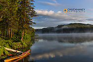 Sunrise with kayak on Beaver Lake in the Stillwater State Forest near Whitefish, Montana, USA