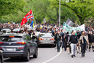 Demonstrators are seen marching through a street stopping any cars along the way during the Freedom protest on October 23, 2020 in Melbourne, Australia. Freedom protests are being held in Melbourne in response to the governments COVID-19 restrictions and continuing removal of liberties despite new cases being on the decline. Victoria recorded a further 1 new cases overnight along with no deaths recorded.(Photo by Mikko Robles/Speed Media)