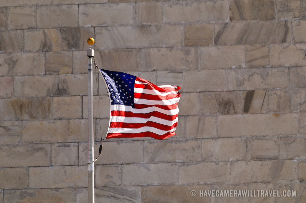 American flags against the side of the Washington Monument on the National Mall