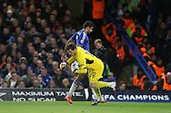 Goalkeeper Iker Casillas of FC Porto dives to try and book Diego Costa of Chelsea for fouling. UEFA Champions league group G match, Chelsea v Porto at Stamford Bridge in London on Wednesday 9th December 2015.<br /> pic by John Patrick Fletcher, Andrew Orchard sports photography.