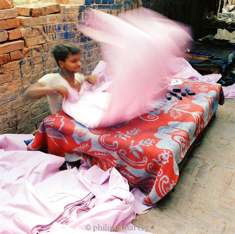 Preparing textiles for block printing, Lucknow, Uttar Pradesh, India