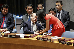 August 6, 2017 - Nikki Haley (R, front), U.S. Permanent Representative to the United Nations, shakes hands with Liu Jieyi, China's Permanent Representative to the United Nations, prior to a Security Council on DPRK, at the UN headquarters in New York. The United Nations Security Council on Saturday unanimously adopted a U.S.-drafted resolution that aims to slash by a third the Democratic People's Republic of Korea's 3 billion U.S. dollars annual export revenue over Pyongyang's two intercontinental ballistic missile (ICBM) tests in July.  (Credit Image: © Li Muzi/Xinhua via ZUMA Wire)