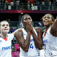07 August 2012: France Isabelle Yacoubou cries after seeing a marriage proposal from her fiance next to Sandrine Gruda, Clemence Beikes following 71-68 Team France victory over Team Czech Republic, during the women's basketball quarter-finals, at the Basketball Arena, in London, Great Britain.