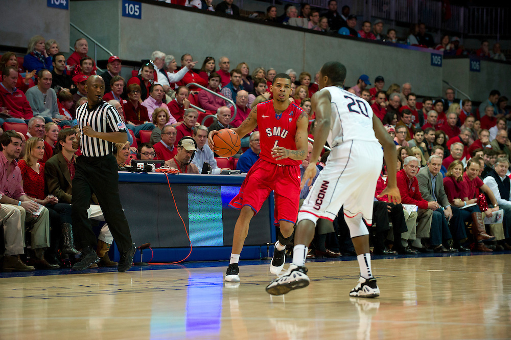 DALLAS, TX - JANUARY 4: Keith Frazier #4 of the SMU Mustangs brings the ball up court against the Connecticut Huskies on January 4, 2014 at Moody Coliseum in Dallas, Texas.  (Photo by Cooper Neill/Getty Images) *** Local Caption *** Keith Frazier