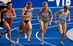 (L-R) Iris Fuentes-Pila of Spain, Christin Wurth-Thomas of USA, Deirdre Byrne of Ireland and Sonja Roman of Slovenia compete in the women's 1500 Metres Heats during day four of the 12th IAAF World Athletics Championships at the Olympic Stadium on August 18, 2009 in Berlin, Germany. (Photo by Vid Ponikvar / Sportida)