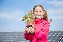 Girl holding plant environmental protection