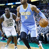 10 February 2013: Denver Nuggets shooting guard Andre Iguodala (9) drives past Boston Celtics power forward Brandon Bass (30) during the Boston Celtics 118-114 3OT victory over the Denver Nuggets at the TD Garden, Boston, Massachusetts, USA.