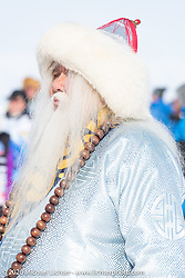 Buryatian performer in indigenous dress at the opening ceremonies of the Baikal Mile Ice Speed Festival. Maksimiha, Siberia, Russia. Saturday, February 29, 2020. Photography ©2020 Michael Lichter.